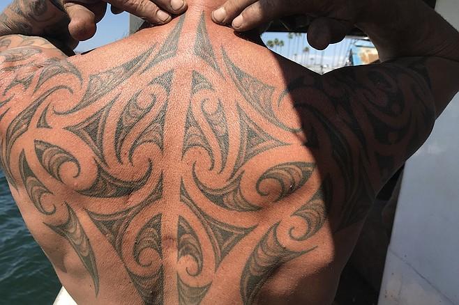Captain Pete Bethune shows his moko - Maori tattoo - showing his whakapapa - genealogy - through symbols