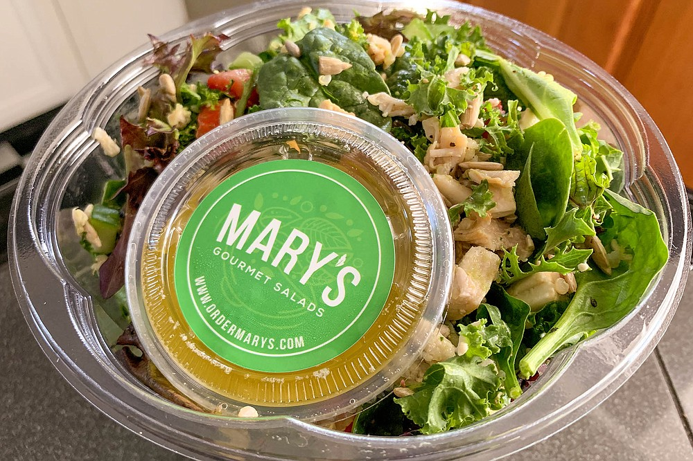 A citrusy salad dressing packaged with a chopped salad of chicken, greens, and veggies