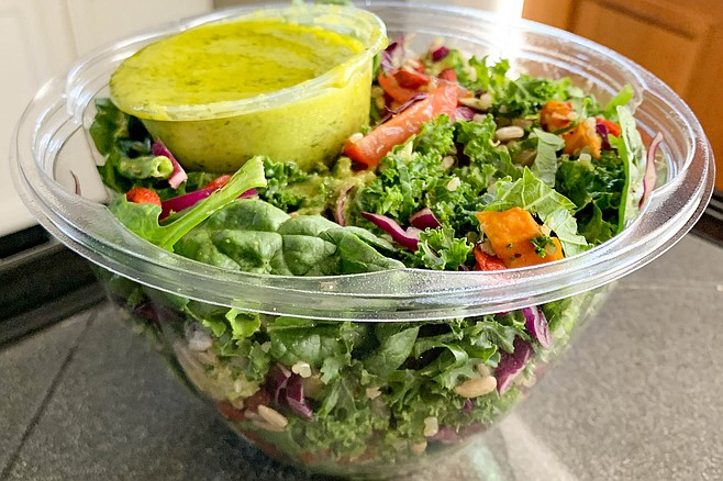 A six cup tub of chopped produce, with herbal green salad dressing