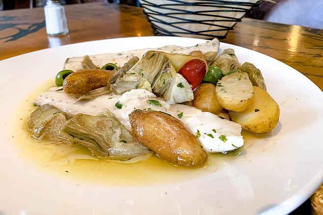 Branzino with olives, artichoke, and potatoes