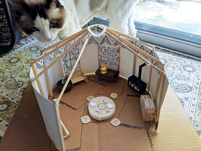 Model of a tent from issue 2 of Patrick and Jessica Reilly's Five Realms comic series (cat for scale). Jessica creates the models to get a more accurate representation for how some of the characters interact with the world.