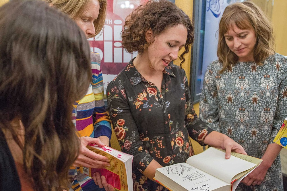 Robin Dodds Lang (center) and Kaitlin Barr Nadal (right) discuss The Great Believers at the One Book, One San Diego launch event on September 19. Robin had her book signed by the author, Rebecca Makkai.