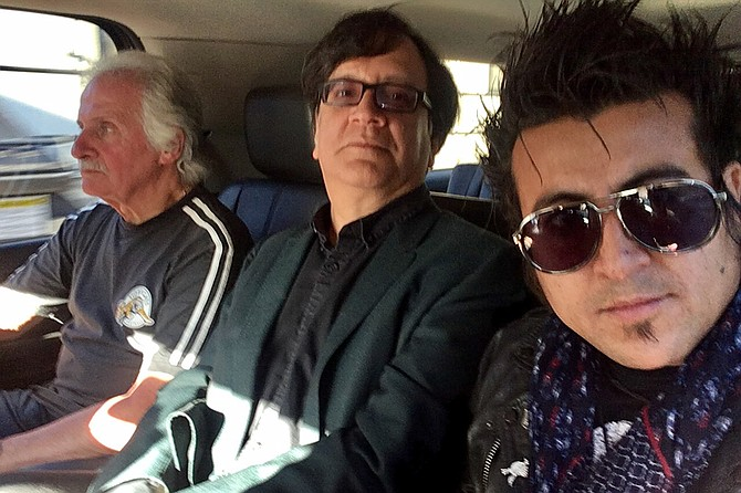 Besties: San Diego rockers (right to left) Chris Leyva and Bart Mendoza ride with original Beatles drummer Pete Best. Leyva served as model for a statue of original Beatles bassist Stuart Sutcliffe.