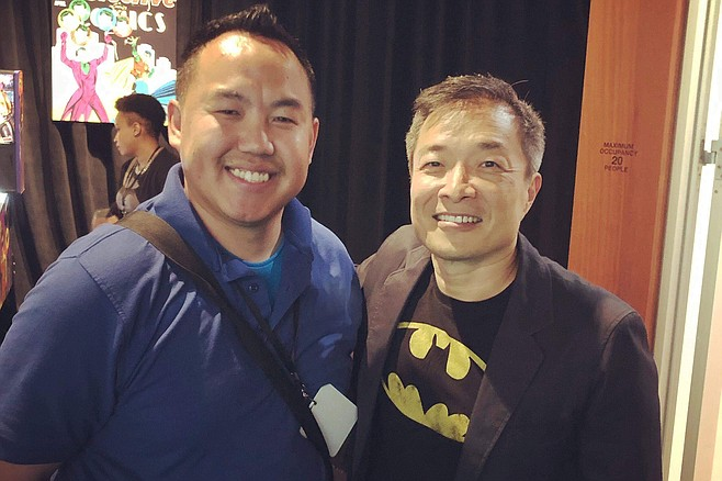Local con-goer Billy Khang (left) found the DC booth and took a photo with Jim Lee, DC's chief creative officer.