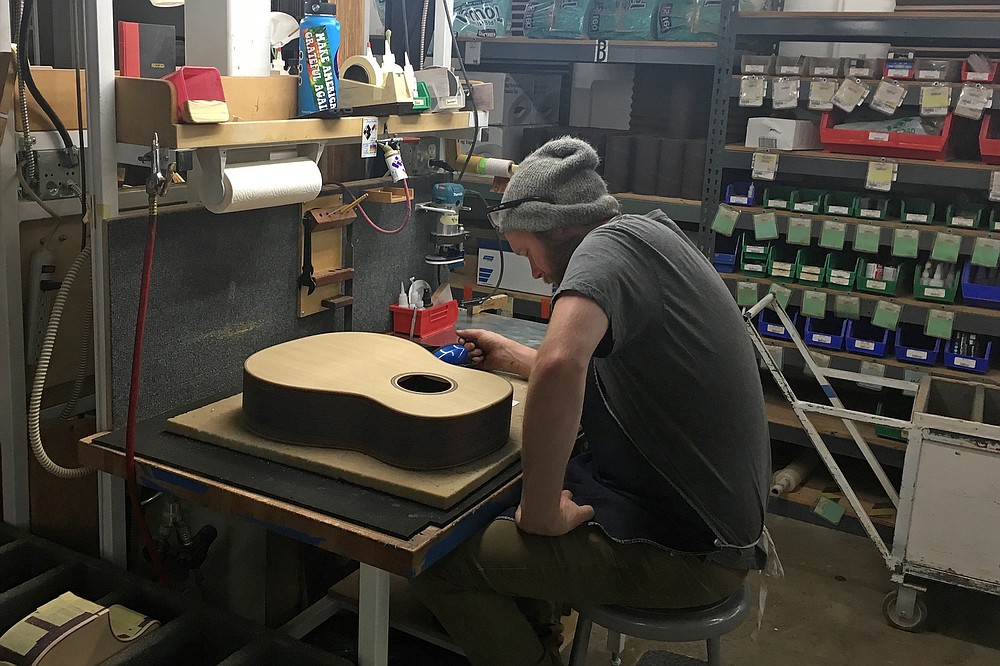 Geppetto at his workbench in the Taylor Guitar factory?