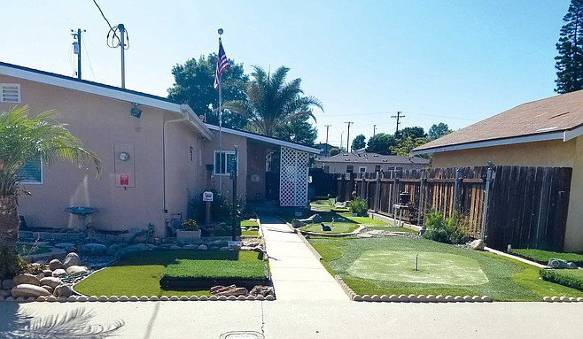 Another University Park homeowner has turned his entire front yard into a miniature golf course.