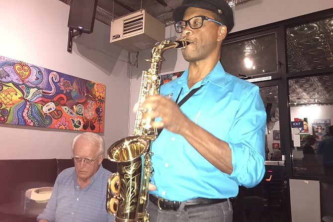 The next Bill Clinton? John Brooks at Latin jazz jam.
