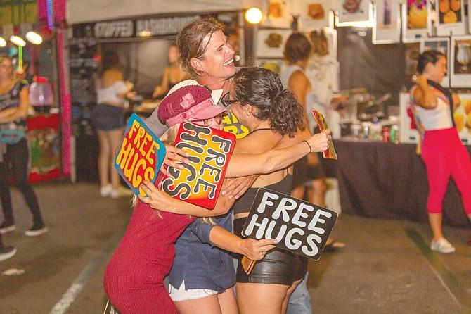 Food, art and free hugs mix lovingly at Thursday evening's Farmer's Market.