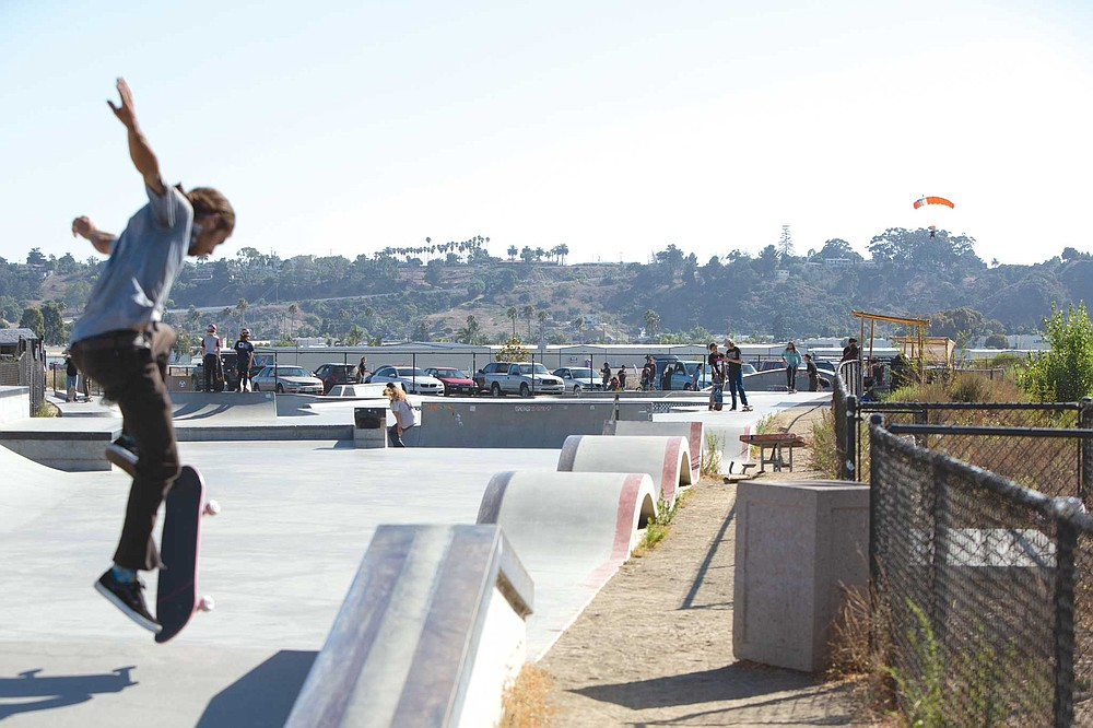 The Oceanside Skate Park. Skaters and skydivers sharing air space.