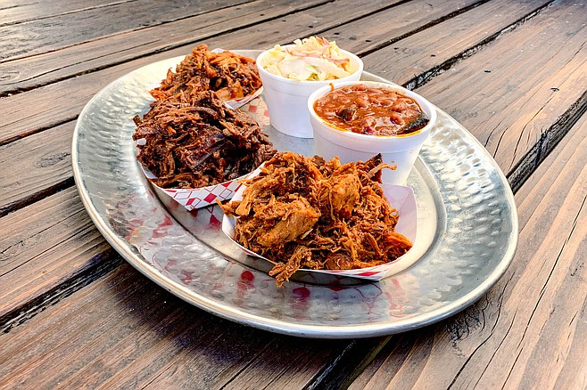 The Up in Smoke Sampler: braised chicken, pulled pork, and chopped brisket, with two sides