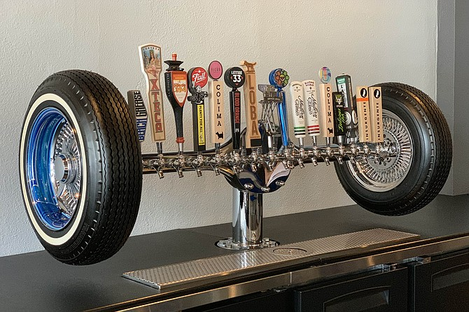 Whitewall tires and blue rims on Barrio Dogg's custom draught system