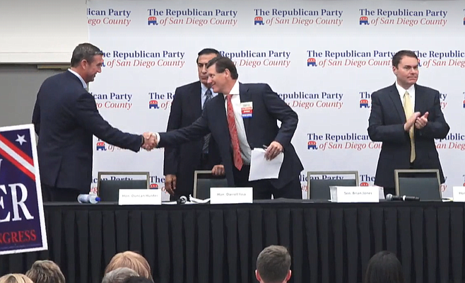 Hunter on left shakes hands with Jones. Issa in back, DeMaio off to right