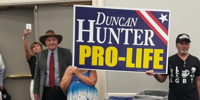 Former Congressman Duncan Hunter, the current congressman's father, on left wearing hat