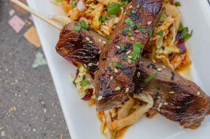 Korean beef skewers with kimchi slaw and cashew curry sauce