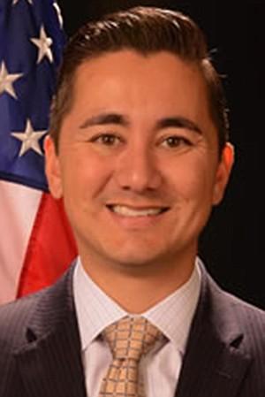 Walmart money makes city councilman Chris Cate smile.