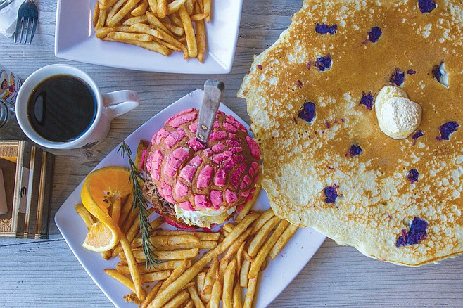 At Mexipino Craft, pancakes are given color not with blueberries, but with pieces of the purple yam ube, and the breakfast sandwich is served on a pink concha.