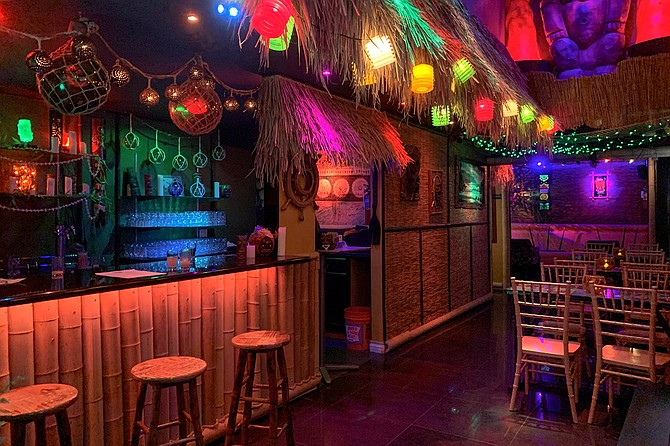 A colorful tiki bar speakeasy where blacklights are just the beginning