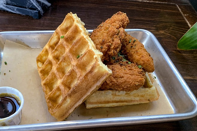 Bruxelles waffle with fried chicken and maple syrup