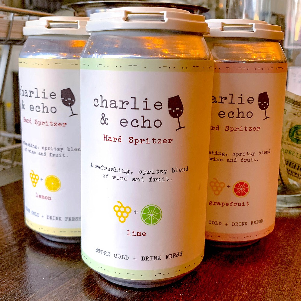 Cans of hard spritzer, a sparkling blend of wine, spring water, citrus fruit and cane sugar