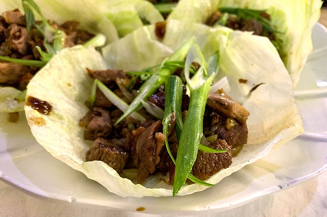 "Duck lettuce wraps, billed as ""lettuce tacos"""