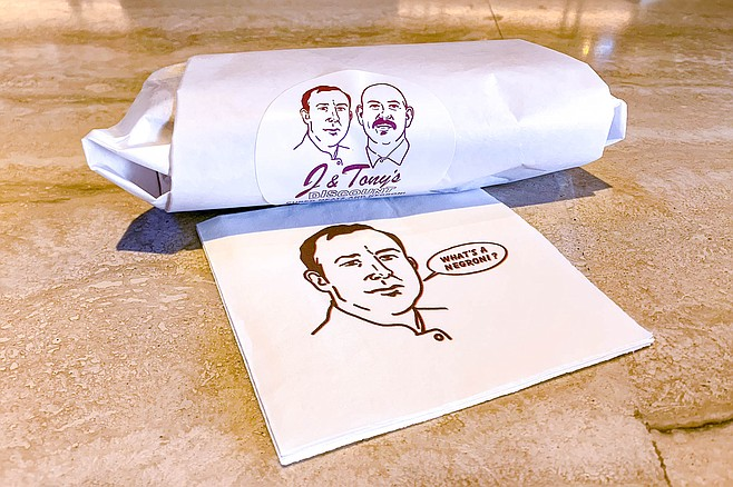 A sandwich wrapped up with J & Tony caricatures