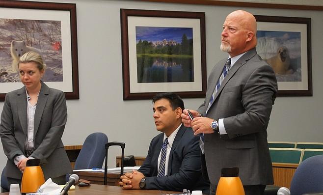 David Carpio, seated; his attorney, Sean Leslie, standing