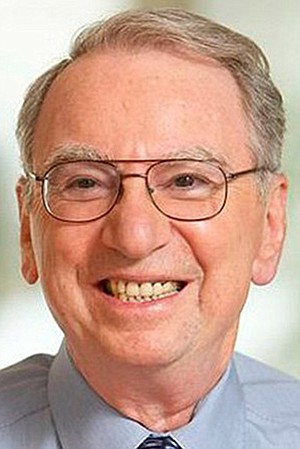 Big donations make Irwin Jacobs smile, especially when profit may result.