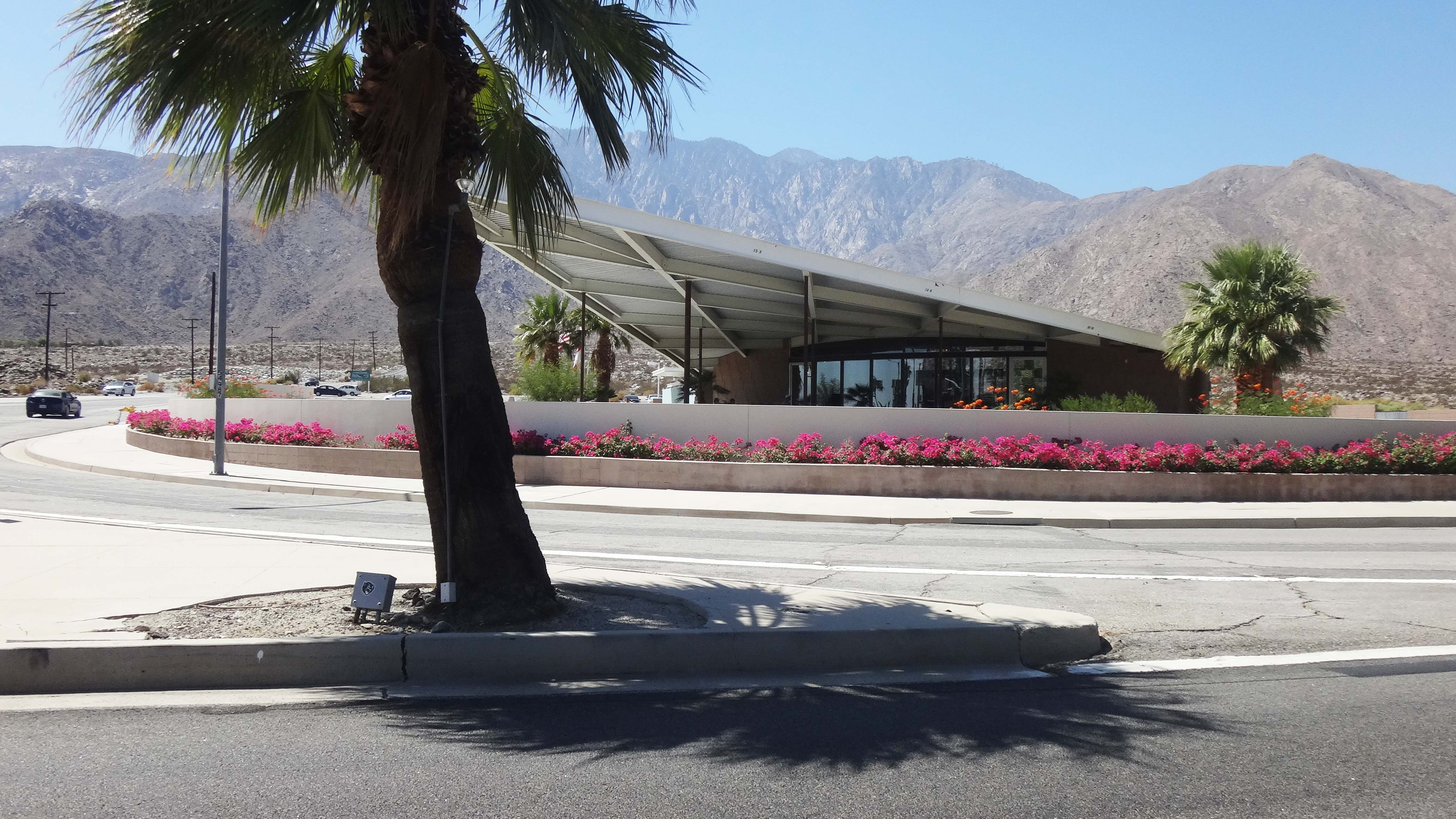 Palm Springs Visitors Center on N. Palm Canyon Drive at Tramview Road.  Many years ago the building was a gas station. Photographed in September 2013.
