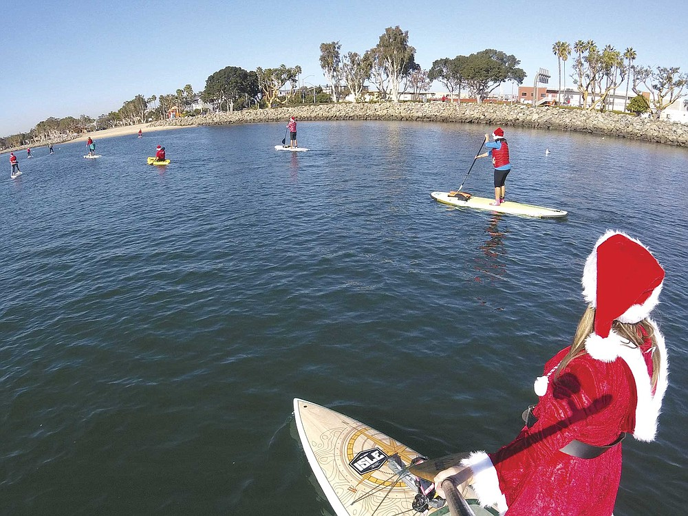 Don your Santa hat and your light-up Christmas earrings to paddle around Mission Bay with other holiday revelers.