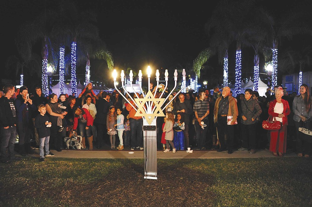 Liberty Station marks the humble Hanukkah holiday with a menorah lighting and festival on the Central Promenade.