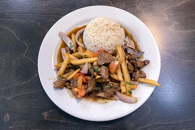 Lomo saltado, a classic Peruvian dish influenced by Chinese stir fry