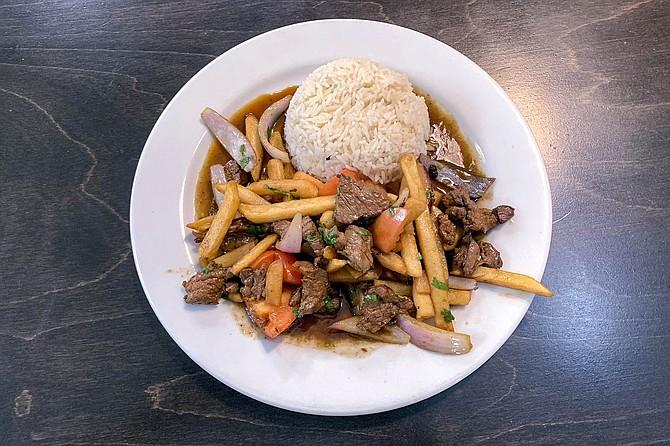 Lomo saltado, a classic Peruvian dish influenced by Chinese stir fry