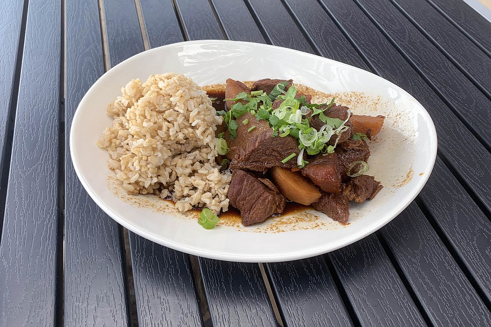 Braised pot roast with a side of rice