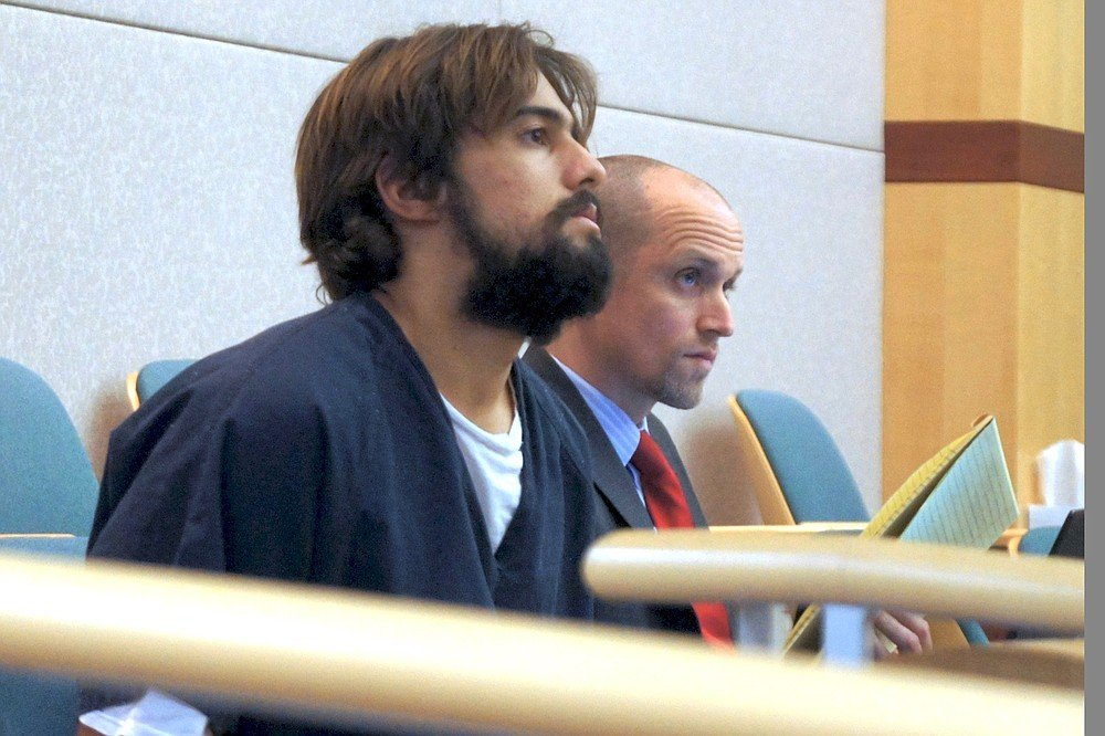 David Rodriguez, here in court with attorney Charles Millioen, was the passenger in the prius that October night.