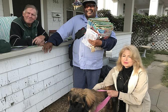 Mail carriers all - John, Jason, Brigitte and friend