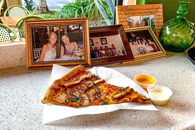 Family photos, and a slice of chicken parm pizza