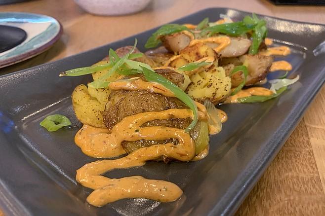 Patatas Bravas with smashed potatoes and a terrific chipotle aioli