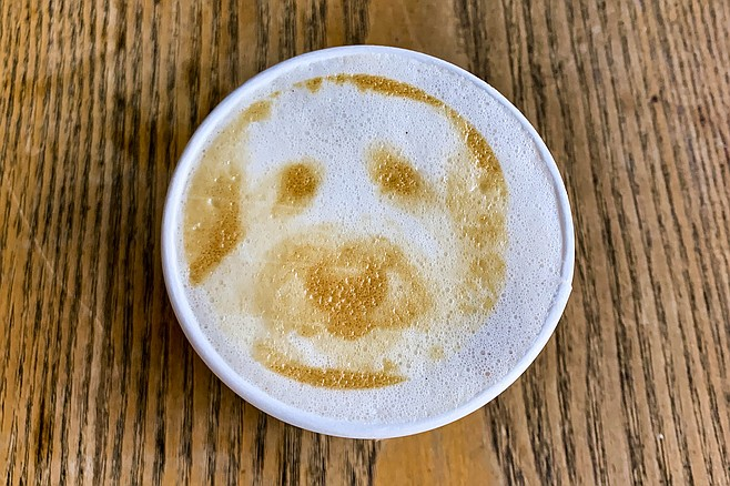 An iPhone dog photo printed on latte foam