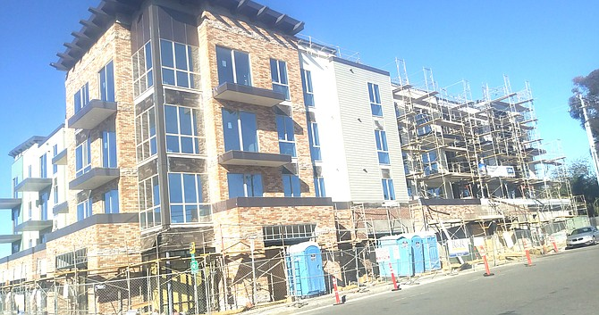 State Mixed Use 30 development – 27 condos plus first-floor commercial use – 33 parking spaces