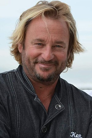 Ken Irvine, executive chef, won't let a deadly stingray attack slow down his surfing