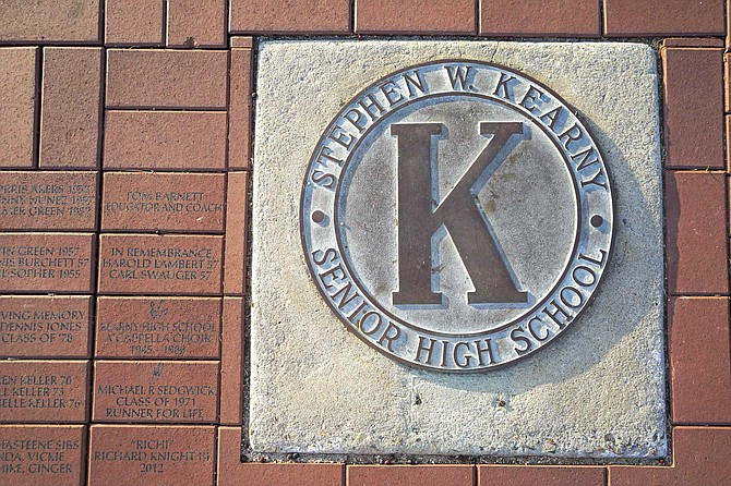 """In the ground, beneath the Kearny Senior High School emblem, is a collection of bricks purchased by alumni and other supporters. """"We've got some great names here,"""" Stephen Grooms says, pointing downward."""