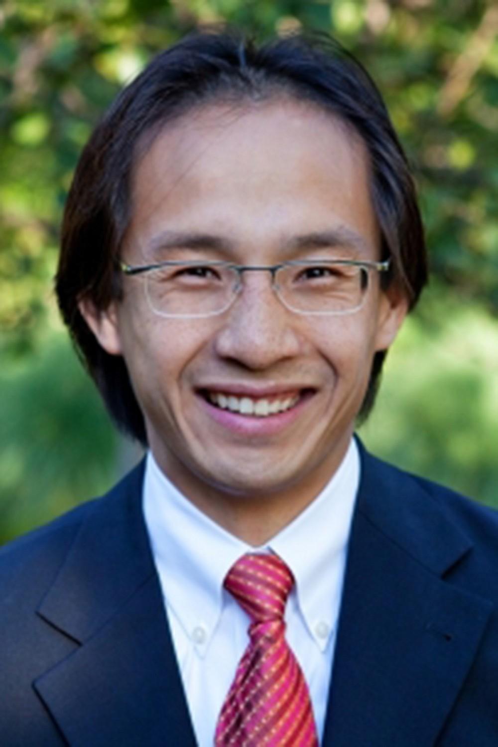 A budget increase of $900,000 makes registrar Michael Vu smile.