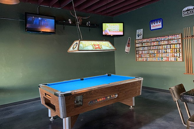 A pool table in the corner, more TVs to come