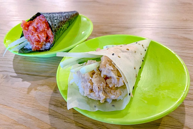 A rice paper hand roll, and a traditional nori hand roll