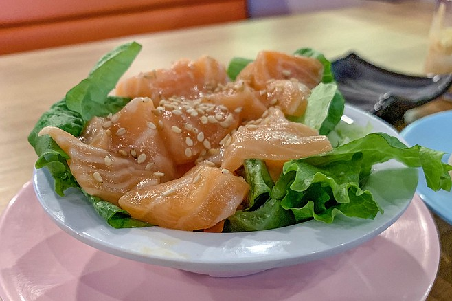 Salmon sashimi plucked from a Mikami Revolving Sushi conveyor belt