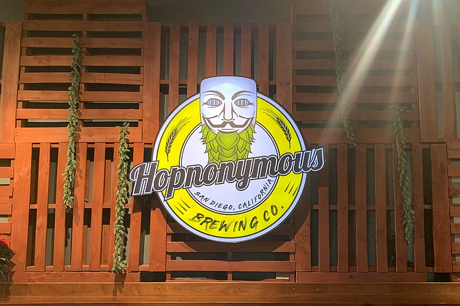 """The """"Anonymous"""" Guy Fawkes mask gets a hop beard for the Hopnonymous logo."""