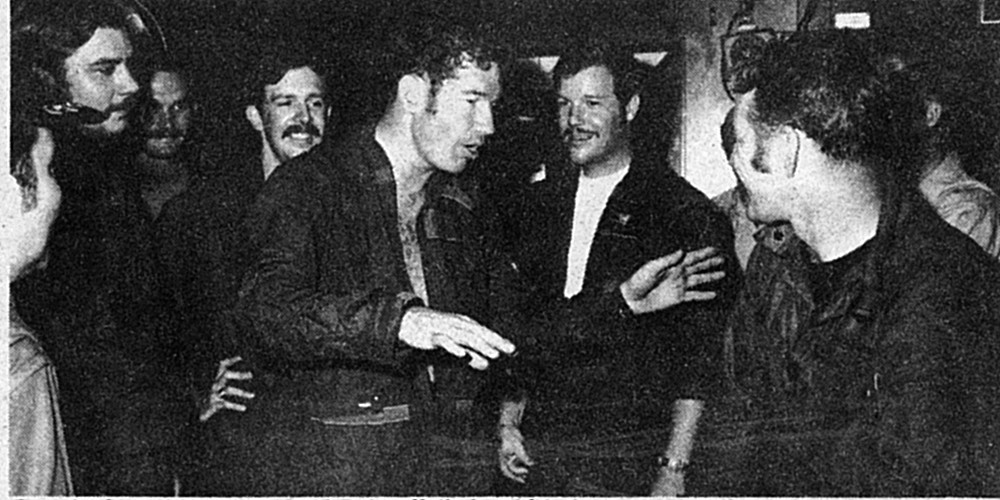 Cunningham (gesturing) and Driscoll (behind him) recounting the Col. Tomb battle, U.S.S. Constellation, May 10, 1972