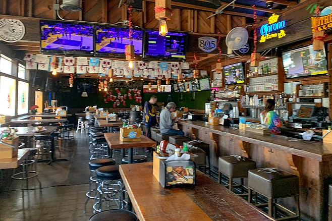 Sports on TV, but no Philly sports paraphernalia at mother's Saloon