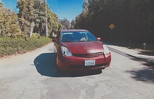 Evidence photo of the red Prius.
