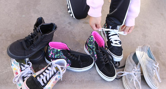 """Eli trying on Vans. """"Imagine how it is buying shoes online for growing kids."""""""